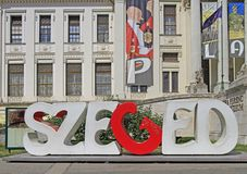City sign of Szeged in front of museum building Stock Photo