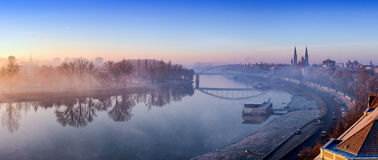 Szeged panorama with Tisza river and Votive Church visible in th. E back. Panoramic image at dusk with fog. HDR image stock image
