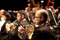The   Szegedi Symphonic Orchestra performs. BUDAPEST, HUNGARY - 2011 FEB 26: Members of the Szegedi Symphonic Orchestra performs at The Thalia Theatre stage Stock Image