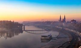 Szeget Венгрия на заходе солнца Votive церковь и река Тисы стоковая фотография