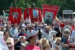 Szekler pilgrims celebrating the Pentecost. SUMULEU CIUC, ROMANIA - MAY 29: Crowds of Szekler pilgrims gather to celebrate the Pentecost and the catholic stock photos