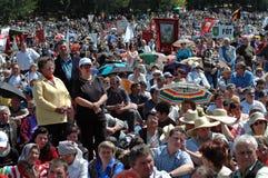 Szekler pilgrims celebrating the Pentecost. SUMULEU CIUC, ROMANIA - MAY 29: Crowds of Szekler pilgrims gather to celebrate the Pentecost and the catholic stock image