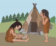 Szene der Herstellung des Feuers an der prähistorischen Regelung Lizenzfreies Stockbild