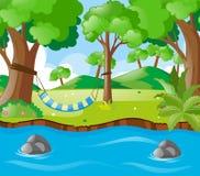 Szene mit Schwingen durch den Fluss Stockbild