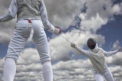 Szermiercze pojedynek chmury Zdjęcia Royalty Free