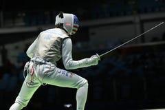 Szermierz Aleksander Massialas Stany Zjednoczone współzawodniczy w mężczyzna ` s drużyny folii Rio 2016 olimpiad przy Carioca are zdjęcie royalty free