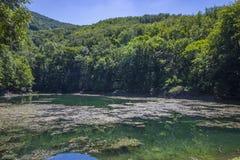 Szilvasvarad - lake with hills Stock Image