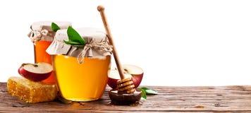 Szkło może foluje miód, jabłka i honeycombs, Obrazy Royalty Free