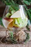 Szkło owoc na Bożenarodzeniowym tle z gałąź elomymi, zima czas zdjęcie royalty free