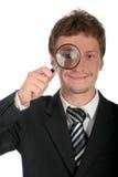 szkło powiększające biznesmena gospodarstwa Zdjęcia Stock