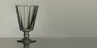 Szkło dla ajerówki na stole Zdjęcia Stock