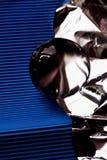 Szklana kula ziemska lub kropla woda na tle błękit gofrująca folia i papier Czyści i Błyszczy Zdjęcie Royalty Free
