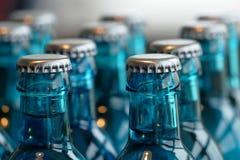 Szklane butelki woda na stole Zdjęcie Royalty Free