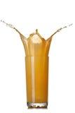 szklanego soku pomarańczowy pluśnięcia biel Zdjęcia Stock