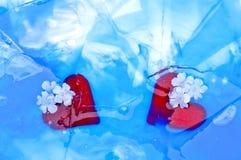 Szklani serca w łamanym lodzie Zdjęcia Royalty Free