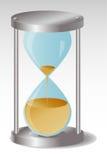Szklany Hourglass z metali kapeluszami, przepuszcza piasek Zdjęcia Stock