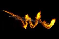 Szklany kordzik i drawed ogień Zdjęcie Royalty Free