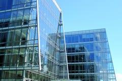 Szklany nad metal buduje nad niebieskim niebem Obrazy Royalty Free