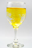 Szklany pełny woda z atramentu kolorem Obraz Royalty Free