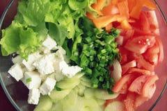 Szklany puchar z cutted warzywami dla sałatki Obraz Stock