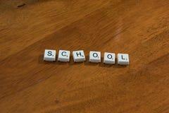 Szkoła literująca out na gemowych kawałkach Zdjęcie Royalty Free