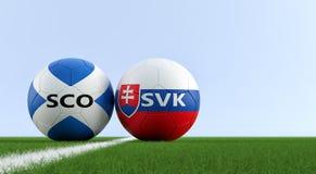 Szkocja vs Sistani mecz piłkarski - piłek nożnych piłki w Szkocja i Sistani krajowych kolorach na boisko do piłki nożnej Fotografia Stock