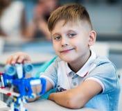 Szkolna chłopiec bawić się z budowa setem Obrazy Royalty Free
