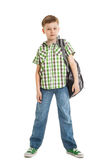 szkolna chłopiec w cajgach z plecakiem odizolowywającym fotografia royalty free