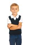 Szkolna chłopiec z rękami składać Obraz Stock
