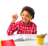 Szkolna chłopiec z słuchawki cieszyć się obraz stock