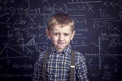 Szkolna chłopiec i blackboard Zdjęcia Stock