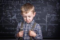 Szkolna chłopiec i blackboard Obrazy Stock