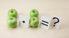Szkolna karta i jabłko z matematyką Obrazy Royalty Free