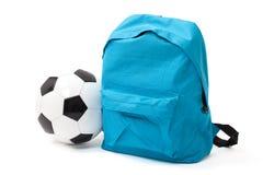 Szkolna torba i piłka z ścinek ścieżką Zdjęcie Stock