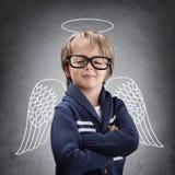 Szkolnej chłopiec anioł z skrzydłami i halo Zdjęcia Royalty Free