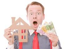 Szokujący biznesowy houseowner z pieniądze Obrazy Royalty Free