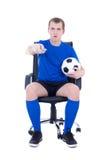 Szokujący mężczyzna z pilot do tv dopatrywania meczem piłkarskim odizolowywającym dalej Obraz Stock