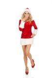 Szokująca młoda piękna Santa kobieta Fotografia Royalty Free