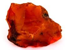 Szorstka czerwona karneol skała odizolowywająca na bielu Zdjęcie Royalty Free