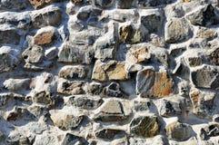 Szorstka solidna kamienna ściana Zdjęcia Royalty Free