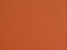Szorstki prosty pomarańczowy betonowej ściany tło, tekstura/ Fotografia Royalty Free