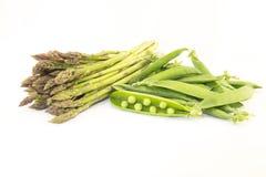 Szparagowi i zieleni grochy Obrazy Stock