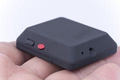 Szpieguje chowaną małą czarną kamerę na ręce zdjęcia royalty free