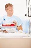 Szpital: Mężczyzna no Lubi Szpitalnego jedzenia Obraz Royalty Free