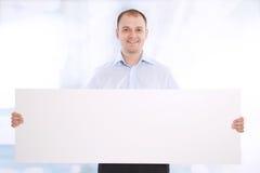 sztandaru biznesowego mężczyzna teraźniejszość target914_0_ biel Fotografia Royalty Free