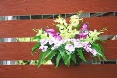Sztuczna orchidea kwitnie na ścianie obraz royalty free