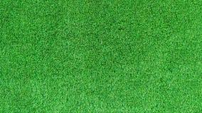 Sztuczna zielonej trawy tekstura lub zielonej trawy tło dla pola golfowego boisko do piłki nożnej lub sportów tło Obrazy Stock
