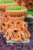 Sztuczny drzewny garnka spojrzenie jak twarz ludzka Zdjęcie Royalty Free