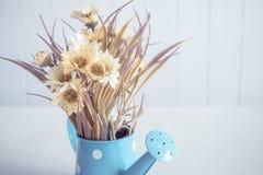 Sztuczny kwiat na rocznika stylu tle Zdjęcia Stock