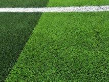 Sztuczny trawy pole z białej linii tłem Zdjęcie Stock